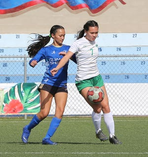 University of Guam Lady Tritons' Colleen Naden controls the ball as Guam Shipyard Women's Minami Rabago pressures her on defense during a Week 10 match of the Bud Light Women's Soccer League Premier Division Sunday at the Guam Football Association National Training Center. UOG and Guam Shipyard battled to a 3-3 draw.