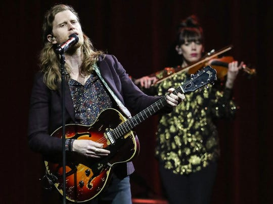 Accompanied by violin player Lauren Jacobson, Wesley Schultz performs with the Lumineers Tuesday at Bankers Life Fieldhouse.