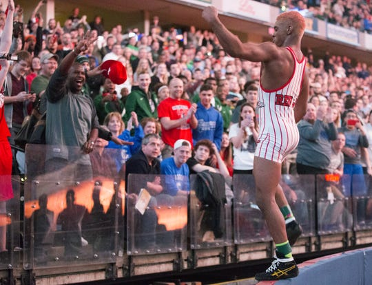 Chad Red of New Palestine High School, hopped on a wall to greet fans after he beat also-undefeated 132 point wrestler Nick Lee, Evansville Mater Dei, IHSAA Wrestling State Finals, Bankers Life Fieldhouse, Indianapolis, Saturday, Feb. 20, 2016. Red finished his pre-collegiate career undefeated.