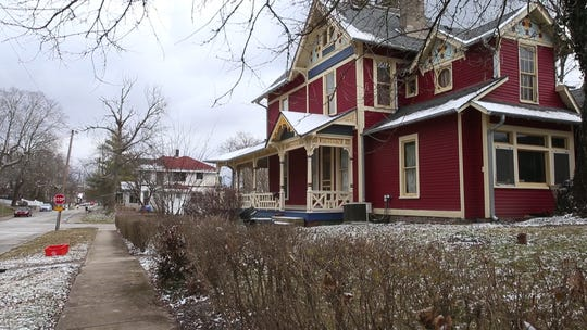 Rob Shilts used the residential facade program to restore the porch and repaint this Queen Anne home at 98 N. Walnut St. in Franklin.