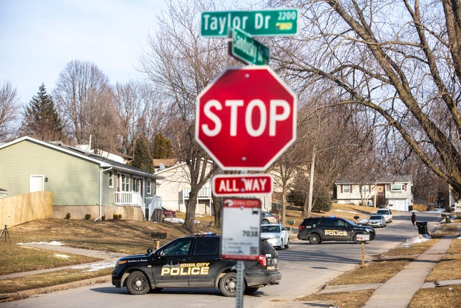 Iowa City police respond to a call of shots fired, Wednesday, Feb. 19, 2020, along Sandusky Drive off of Taylor Drive in Iowa City, Iowa.