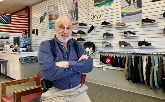 Terry Abeles talks about the kybun and Joya brands sold at T Abeles & Sons in Ridgeland, while his son, Ted Abeles, handles a phone call.
