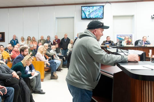 Jason Williams, who is sick from exposire to coal ash, addresses the Anderson County Commission on Tuesday, February 18, 2020 during a public hearing regarding TVA's bid for a new coal ash dump in Anderson County.
