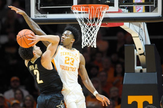 Tennessee guard Jordan Bowden (23) defends against a shot by Vanderbilt guard Scotty Pippen Jr. (2) during a game between Tennessee and Vanderbilt at Thompson-Boling Arena in Knoxville, Tenn. on Tuesday, Feb. 18, 2020.