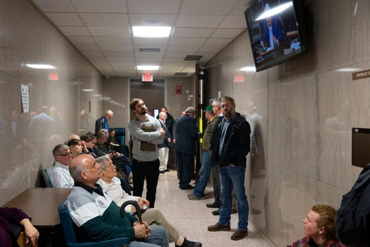 Overflow from the Anderson County Commission's public hearing on TVA's bid for a new coal ash dump fill into the hallway at the Anderson County Courthouse on Tuesday, February 18, 2020.