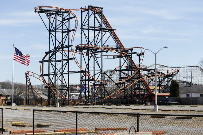 A ride looms behind an empty parking lot at Indiana Beach, Wednesday, Feb. 19, 2020 in Monticello. Apex Parks Group announced Tuesday to White County officials it was closing the popular Indiana Beach amusement park that has operated on Lake Shafer since 1926.