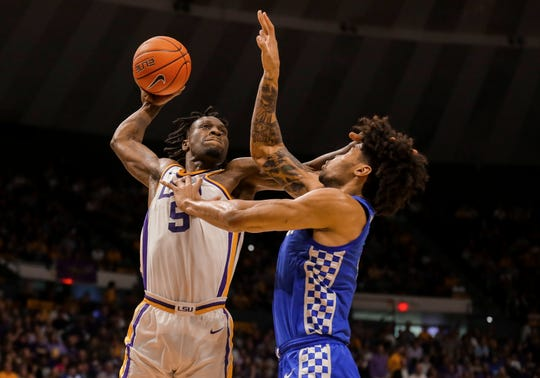 Feb 18, 2020; Baton Rouge, Louisiana, USA; LSU Tigers forward Emmitt Williams (5) attempts to dunk against Kentucky Wildcats forward Nick Richards (4) during the second half at the Maravich Assembly Center. Mandatory Credit: Derick E. Hingle-USA TODAY Sports