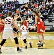 Amanda-Clearcreek's Katelynn Connell shoots over Johnstown's Ryan Helmke during the Aces' 38-34 win Tuesday night.