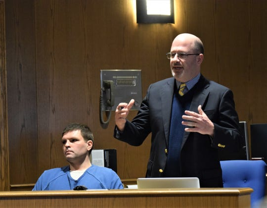 Scott Wood stands to speak on behalf of his client, Arthur Newman, seated, during Newman's sentencing hearing Feb. 19. A jury found Newman guilty of multiple felonies, including grand theft and improper use of a certificate.