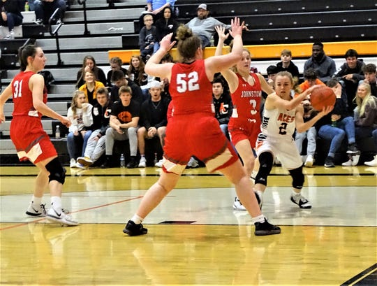 Amanda-Clearcreek's Kilynn Guiler looks  to pass the ball against Johnstown's defense during the Aces' 38-34 win Tuesday night.