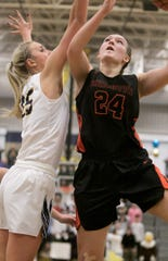 Brighton's Sophie Dziekan (24) and Hartland's Whitney Sollom (25) hoped to meet in the state basketball semifinals before the MHSAA suspended postseason play.