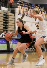 Brighton's Sophie Dziekan (dribbling) and Hartland's Whitney Sollom could meet for the final time in their four-year careers in the state semifinals at the Breslin Center.