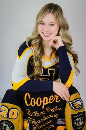 MHSAA Scholar-Athlete Award winner Morgan Cooper is a member of Hartland's competitive and sideline cheer teams, as well as the lacrosse team.
