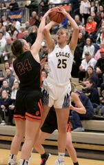 Hartland's Whitney Sollom (25) and Brighton's Sophie Dziekan (24) met 11 times during their high school basketball careers.