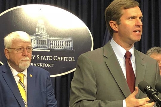 Kentucky Gov. Andy Beshear, right, promotes a bill to cap out-of-pocket costs for many Kentuckians relying on insulin on Tuesday, Feb. 18, 2020, in Frankfort, Ky. The Democratic governor was joined by a bipartisan group of lawmakers, including Republican state Rep. Danny Bentley, the bill's lead sponsor.