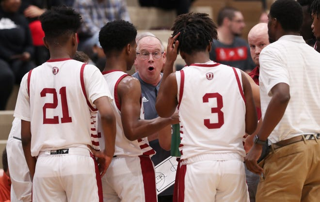 Ballard head coach Chris Renner instructs his team against Seneca during their game at Ballard High School in Louisville, Ky. on Feb. 18, 2020.