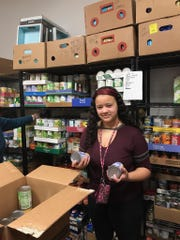 Noe Middle student Alyssa Oliver collected canned goods for her church as part of a school project.