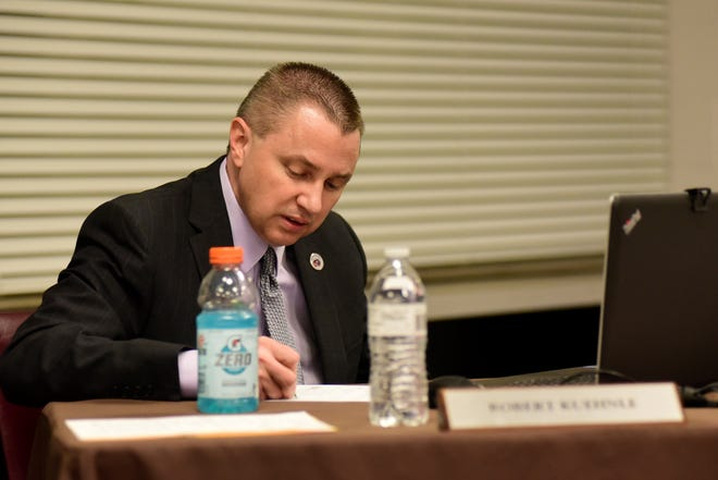 Robert Kuehnle calls the roll Tuesday as members of the Mansfield City School Board voted 4-1 to place him on paid administrative leave as the district's treasurer.