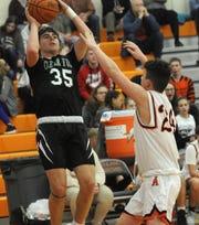 (NJ) Clear Fork High School's Jared Scott (35) shoots over Ashland High School's Grayson Steury (24) in boys basketball action Tuesday, Feb. 18, 2020 at Arrow Arena.