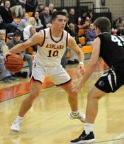 Ashland High School's Mitchell Heilman (10) takes the ball around Clear Fork High School's Brady Tedrow (45) in boys basketball action Tuesday, Feb. 18, 2020 at Arrow Arena.