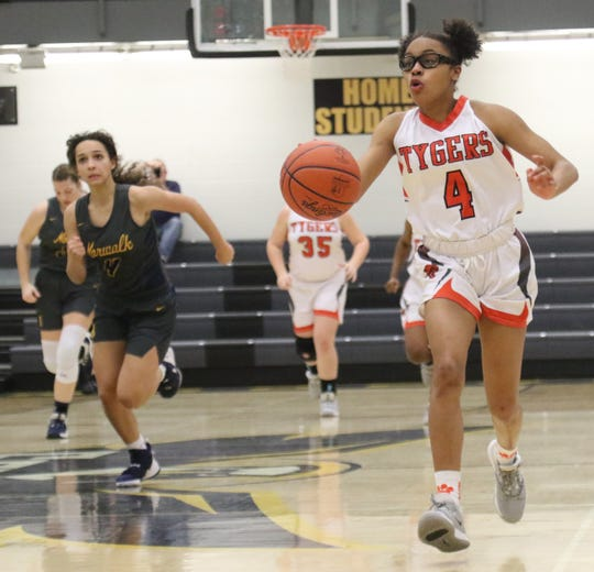Mansfield Senior's Dakiyah White scored 15 points for the Lady Tygers in a win over Norwalk on Tuesday night.