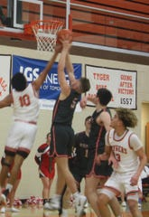 Mansfield Senior's Cam Todd attempts to block a shot by Shelby's TJ Pugh in Tuesday night's game.