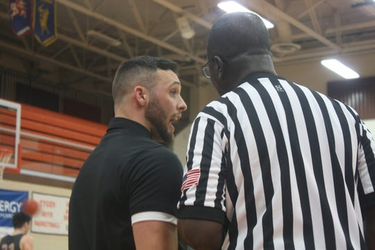 Shelby coach Nathon Loney tries to make a point with the official during Tuesday's 66-59 double overtime loss to Mansfield Senior