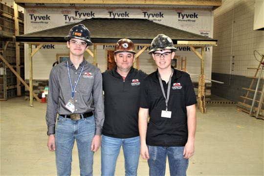 Brothers Jacob, left, and Matthew Sayers, right, are students in the construction trades academy at Tri-Rivers Career Center in Marion. The Sayers brothers said they were inspired by their father, Nathan Sayers, to pursue a career in the construction industry. The Sayers brothers are shown with David Willey, the head of the construction trades academy at Tri-Rivers.