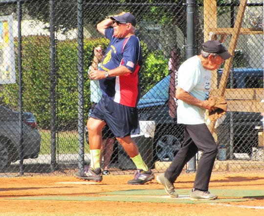 Rick Condle of the American Legion Post is out by less than half a step as Doreen's Bill Moors makes the put out at home plate.