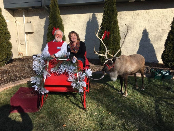 Cheri Schadeberg, pictured riding a sleigh with another Germantown Kiwanis member, Dick Brunow, has been named Germantown Chamber of Commerce Citizen of the Year. Schadeberg has chaired the Kiwanis' Breakfast with Santa event for the last three years.