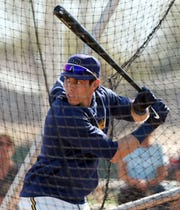 Christian Yelich gets in his cuts during batting practice Tuesday.