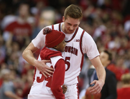 Badgers forward Nate Reuvers hugs young Jerrell Moore after UW's victory over Purdue. Moore is the son of UW assistant coach Harold Moore, who is still recovering from injuries suffered in an automobile accident last year.