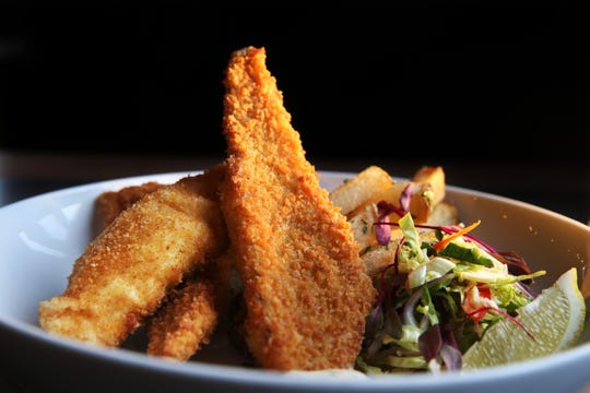 Perch is the centerpiece for Hotel Madrid's Friday fish fry, which includes brussels sprout slaw, thick house fries and dill caper sauce.