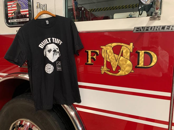 """JBs Tee Shirt Factory made """"Built Tuff"""" T-shirts in honor of Tuff, an English bulldog pulled from the icy waters of Lake Michigan by the South Milwaukee Fire Department. Proceeds will help the department purchase more water rescue equipment and some will go to K9's for Warriors."""
