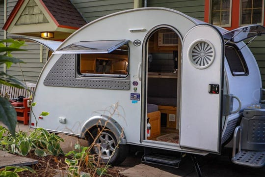 """Staying in this tiny camper is billed as """"a stylish camping experience in a quaint urban garden setting."""""""