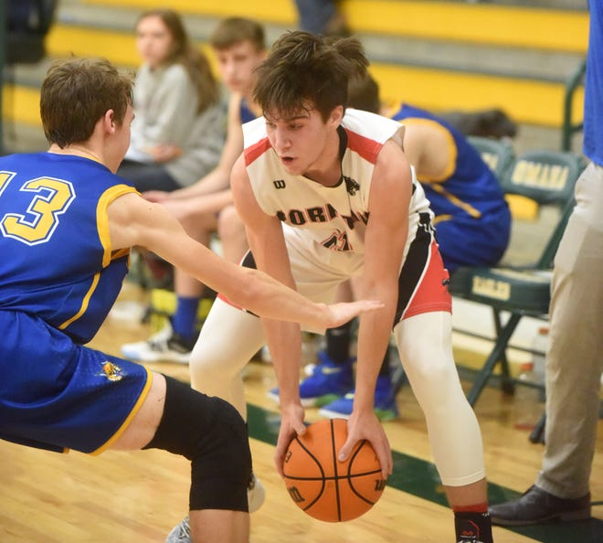 Norfork's Tyler Sorters looks to dribble past his defender during the Panthers' district game against St. Joe on Monday night.