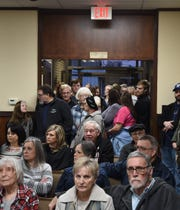 An overflow crowd of at least 100 spills out into the entryway of Mountain Home City Hall on Tuesday night. Area residents packed inside Council Chambers to discuss a proposed community/aquatic center.