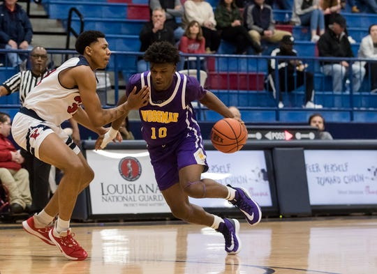 Wossman's Nick Traylor (10) attempts to dribble around West Monroe's Keagan Moncrief (32) during the game at West Monroe High School. Traylor had 24 points and 10 rebounds for the Wildcats.
