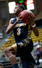 Autaugaville's Dontrell Wilson (3) goes to the hoop against Francis Marion in AHSAA regional basketball action in Montgomery, Ala., on Tuesday February 18, 2020.