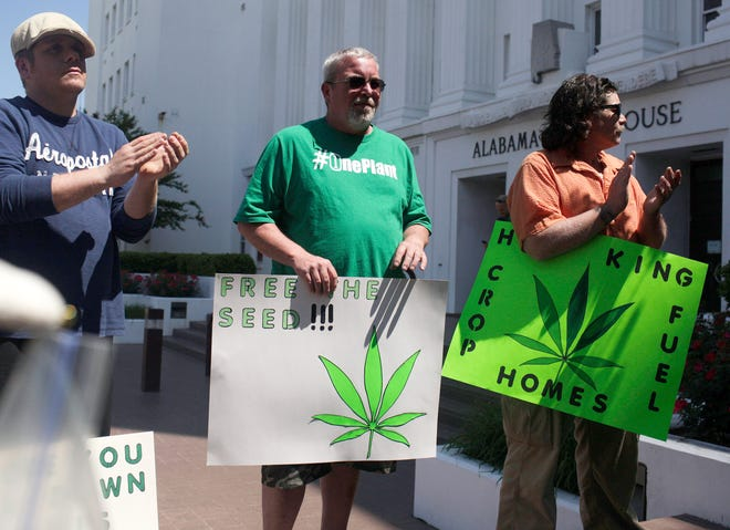 In this April 22, 2015 file photo, residents of Alabama stand outside of the state house in favor of medicinal marijuana legalization at a rally in Montgomery, Ala. A bill to allow medical marijuana cleared its first hurdle Wednesday, Feb. 19, 2020, in the Alabama Legislature, giving hope to advocates after years of setbacks.