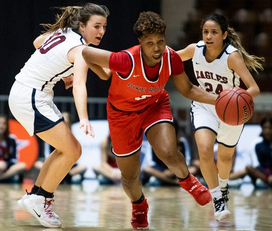 Pike Road's Sheria Clement (3) breaks away from Montgomery Academy's Madi Caddell (10) and Gabby Ramirez (24) in AHSAA regional action in Montgomery, Ala., on Wednesday February 19, 2020.