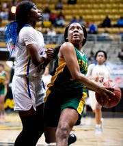 Central-Hayneville's Kadaijah Williams (12) goes to the hoop against Aliceville's Desiree Hawkins (20) in AHSAA regional action in Montgomery, Ala., on Wednesday February 19, 2020.