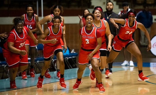 Pike Road players sprint out to claim their regional trophy after defeating Montgomery Academy in AHSAA regional action in Montgomery, Ala., on Wednesday February 19, 2020.