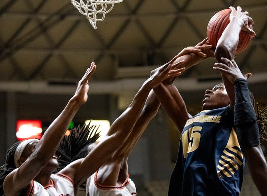 Autaugaville's DeWaun Stubbs (15) is fouled by Francis Marion as he goes to the hoop in AHSAA regional basketball action in Montgomery, Ala., on Tuesday February 18, 2020.