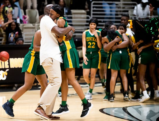 Central-Hayneville coach Terry Thomas picks up Laurianna Myles (20) after the win over Aliceville  in AHSAA regional action in Montgomery, Ala., on Wednesday February 19, 2020.