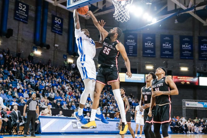BSU redshirt senior forward Tahjai Teague goes up for a block Tuesday, Feb. 18, 2020, during the Cardinals' game at Buffalo. Ball State lost.