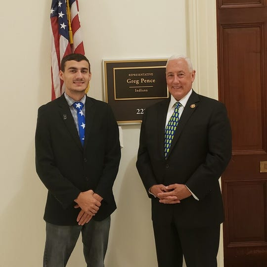 Matthew Peiffer with Congressman Greg Pence. Peiffer has helped influence four state laws involving foster care and adoption.