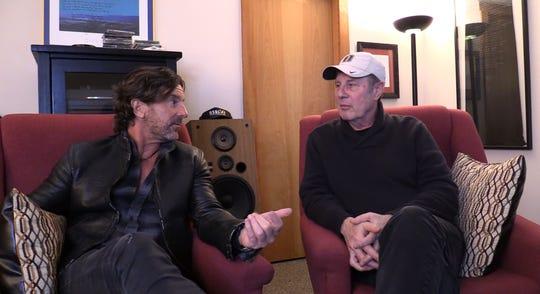 Brett James, left, talks songwriting with Bart Herbison.