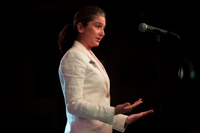 """Lizzy Arnett Chin tells her """"Unique Florida"""" story during a Storytellers Project event at Off The Hook Comedy Club in Naples on Tuesday."""