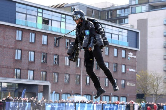 Richard Browning, inventor of the Jet Suit, flies over Brayford Pool in Lincoln, UK.